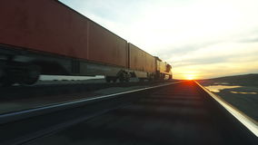 Freight train with cargo containers. Against Sunrise. logistic concept. Realistic cinematic 4k. stock video