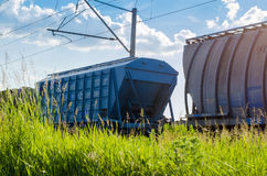 Freight train with cargo. Freight train transporting different cargo in containers and different transport Stock Images