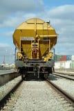 Freight train cargo wagon. Yellow freight train cargo wagon in the train station Stock Photos
