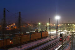 Freight train with carriages move on railways Royalty Free Stock Photography