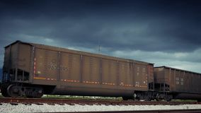 Freight Train Carriages Passing With Dramatic Sky stock video