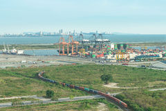 Freight train carrier container into port, Singapore Stock Images