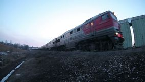 Freight train carries oil drums cars, winter. Evening video gopro stock video footage