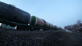 Freight train carries oil drums cars, winter stock video footage