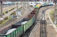 Freight train carrying gravel in wagons Royalty Free Stock Photos