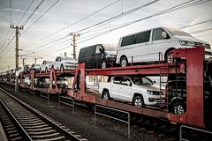 Freight train carrying many cars.  Stock Image