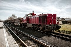 Freight train carrying wood. In the morning Stock Photography