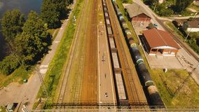 Freight train on the railway. Freight train with cisterns and containers on the railway. Aerial view Container Freight Train, Locomotive to the railway station stock video