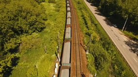 Freight train on the railway. Freight train with cisterns and containers on the railway. Aerial view Container Freight Train, Locomotive in the countryside stock video footage