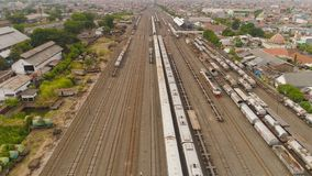 Railway station in Surabaya Indonesia. Freight train with cisterns and containers on railway station Surabaya Indonesia. Wagons with goods on railroad. Heavy stock images