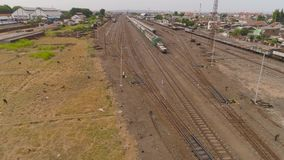 Railway station in Surabaya Indonesia. Freight train with cisterns and containers on railway station Surabaya Indonesia. Wagons with goods on railroad. Heavy stock video footage
