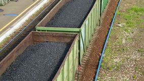 Freight train with coal moving on train station stock video