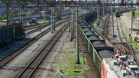 Freight train with coal moving on train station stock footage