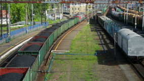 Freight train with coal moving on train station.  stock video footage