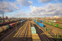 Freight train with color cargo containers. Passing railway station Royalty Free Stock Photo