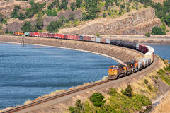 Freight train in Columbia Gorge. Columbia River Gorge, WA, USA July 10, 2008: Eastbound Burlington Northern BNSF freight train winding along banks of Columbia Stock Photo