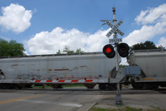 Freight train at crossing gate Stock Photography