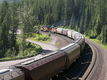 Freight train crossing the mountains Stock Photography