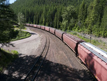 Freight train crossing the mountains Stock Photo