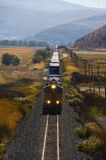 Freight train in the desert mountains. Stock Photo