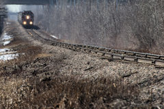 Freight Train in the distance on hot hazy day Royalty Free Stock Photo