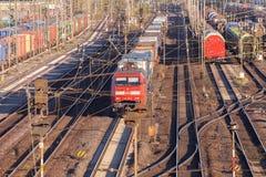 Freight train from german rail, deutsche bahn, drives through the freight yard Royalty Free Stock Photos