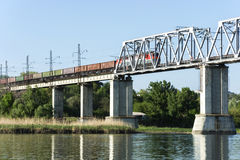 Freight train. A freight train goes over the bridge across the bridge Stock Images
