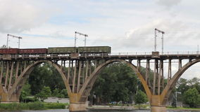 Freight train going over the bridge stock video footage