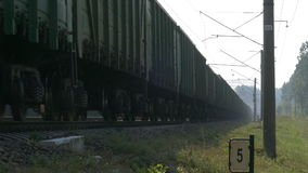 Freight train going past the camera stock video footage