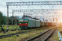 Freight train green with cargo cars on the railway. Freight train green with cargo cars on the railway Stock Image