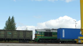 Freight Train with Grey Waggons Arrives to Plant Platform. KAZAN, TATARSTAN/RUSSIA - JUNE 08 2015: Freight train with grey metal waggons arrives to production stock video