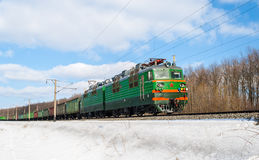 Freight Train Hauled By Electric Locomotive Stock Images