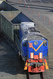 Freight train hauled by diesel locomotive. Stock Photo
