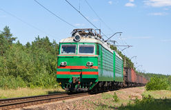 Freight train hauled by electric locomotive Stock Image