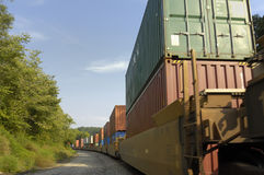 Freight Train Hauls Goods to Market. Knoxville, Tennessee, USA, August 23, 2006: Freight Train hauling double boxcars full of consumer goods to the markets Royalty Free Stock Image