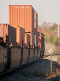 Freight Train Heading West. A heavy freight train heads west at sunrise Royalty Free Stock Photos