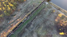 Freight train from a height, a freight train coming into the station, the drone flying over the freight train. View from the sky on a freight train loaded with stock video footage