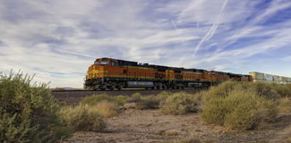 Freight train at high speed. Freight train ride at high speed through the desert Royalty Free Stock Image