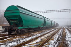 Freight train with hopper cars in the fog. Freight train in the fog Royalty Free Stock Images