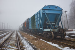 Freight train with hopper cars in the fog. Freight train in the fog Stock Images