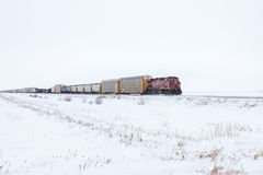 Freight Train On Horizon in Winter Stock Images