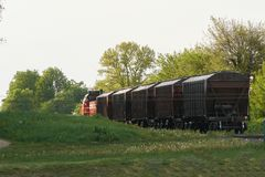 Freight train leaves the city stock photos