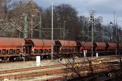 Freight train loaded with lignite. On railroad tracks royalty free stock photography