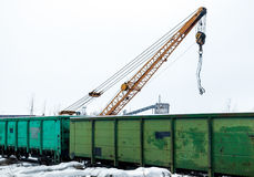 Freight train. In loading under crane in an industrial area Stock Photo