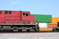 Freight train locomotive and cargo containers Stock Photos