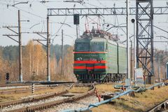 Freight train locomotive carrying with cargo on daylight.  Royalty Free Stock Images