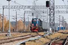 Freight train locomotive carrying with cargo on daylight.  Royalty Free Stock Image