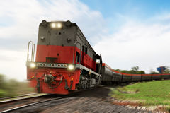 Freight train locomotive carrying with cargo. On daylight Royalty Free Stock Photography