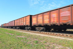 Freight train in motion. Under the blue sky Stock Image