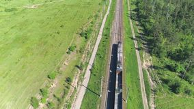The freight train moves along the railway track.  stock video